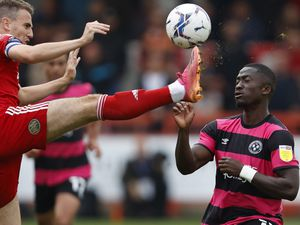 Dan Udoh of Shrewsbury Town and Sean McConville of Accrington Stanley (AMA)