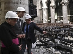 Canada's Justin Trudeau dons a hard hat as he visits fire-ravaged Notre Dame