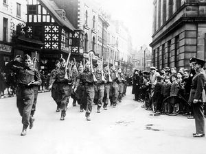 """nostalgia pic. Shrewsbury. A Home Guard parade through Shrewsbury in October 1940. This picture was carried in the Shrewsbury Chronicle of Friday, November 1, 1940. The caption read: """"Shrewsbury Home Guard parade on Sunday. Lord Bradford takes the salute."""" Picture sent in by Mr Graham Emberton, of Bayston Hill, 01743 872489. His father Reg Emberton is on the picture. The location is High Street, Shrewsbury, with the old Shirehall on the right. Reg Emberton was founder of Walker Emberton & Co of Shrewsbury in 1946 (it closed 2006). Mr Reg Emberton is (as you look at the picture) in the right hand file of soldiers, second from the front (.ie. the front excluding the saluting soldier). Graham says: """"In the background is the old McClures shop - that's the one with a light name board over the top of it with a domed piece in the middle. The black and white building was, I think, Bradley's outfitters. They had a place in Wellington as well. I know the names of two of them at the front. Not the man that's saluting, the one to his left - to the right as you look at the picture - the tall man I think was Keith North. The one to his left in front of my father, I'm not sure but I think his surname was Ebury. Not immediately behind my father, but the one beyond, I think was Alan Daborn. """"My father worked at what was Della Porta's and then set up on his own with another chappie called Walker in 1946. It was a household, textiles, and soft furnishing shop in Princess Street."""" Home Guard parade. Military parade. Shrewsbury street scene, general view. Library code: Shrewsbury nostalgia 2009."""