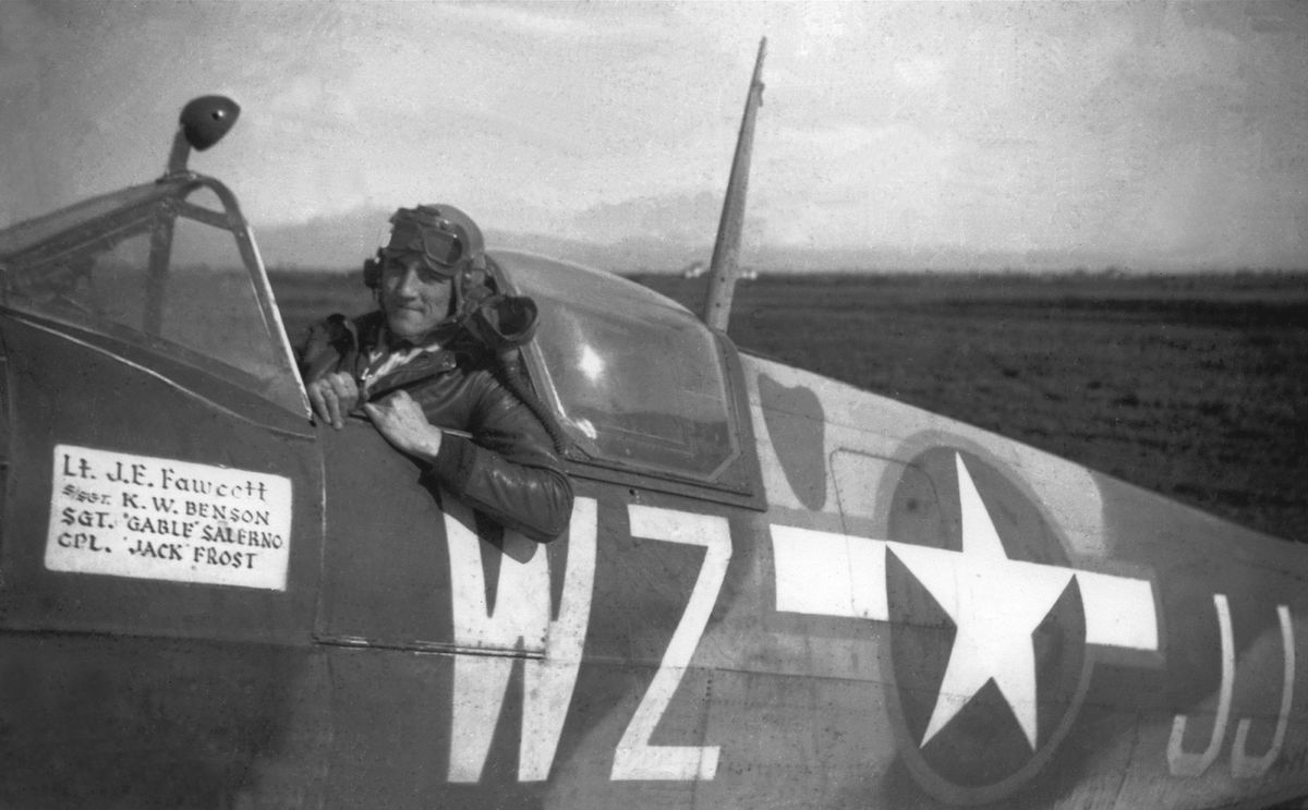 First Lieutenant John Fawcett smiles from the cockpit of his newly painted Spitfire dubbed Lady Ellen III.