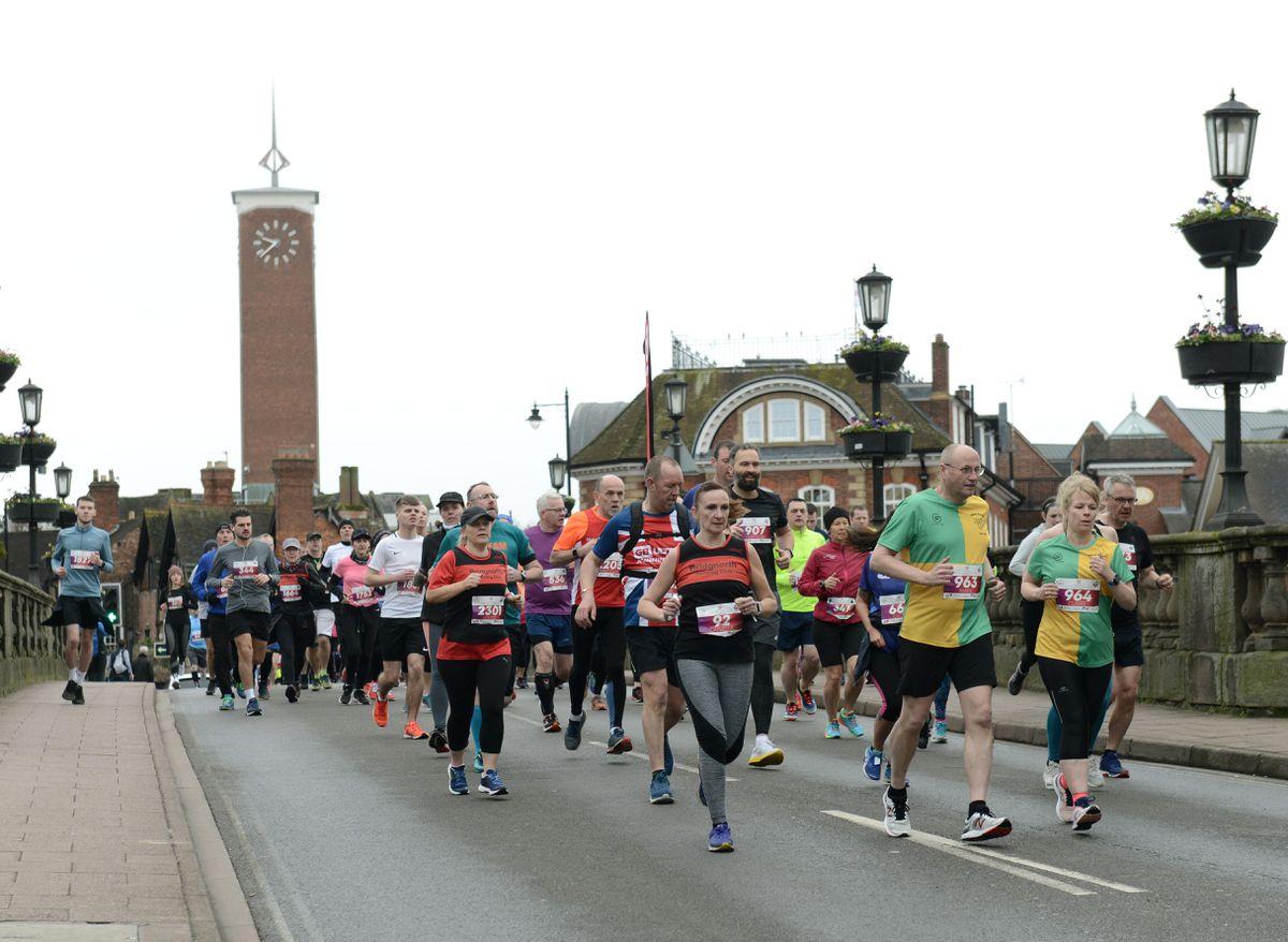 Runners crossing the Welsh Bridge as the Shrewsbury 10k run gets underway