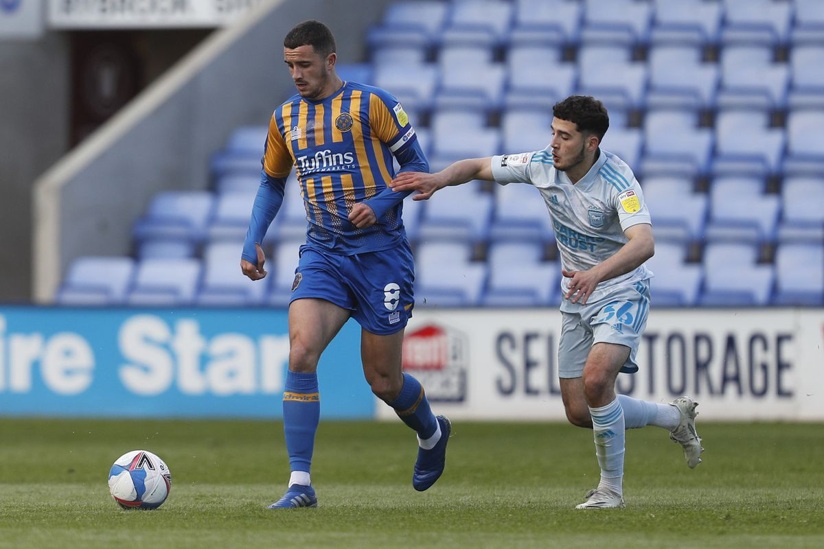 Ollie Norburn of Shrewsbury Town and Armando Dobra of Ipswich Town. (AMA)