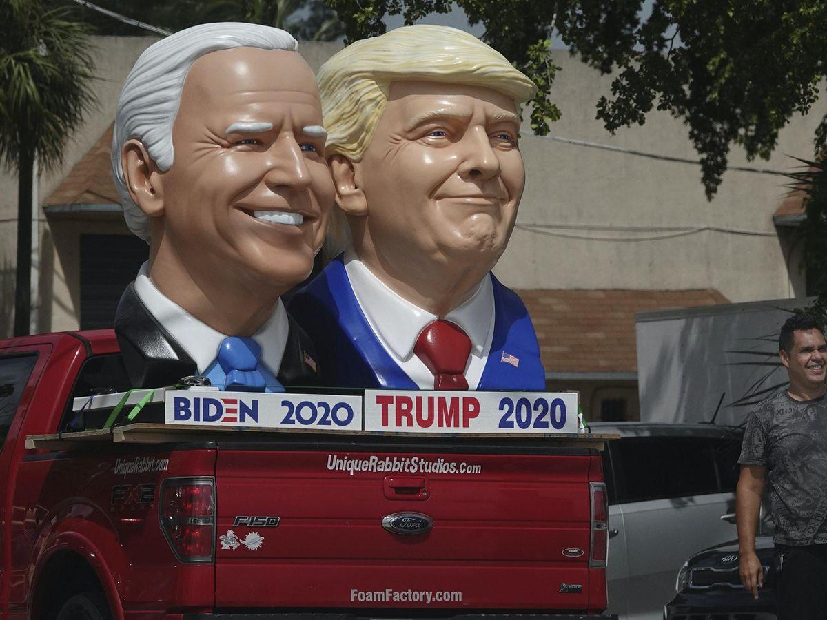 Foam sculpture depictions of President Donald Trump and Democratic presidential candidate former Vice President Joe Biden along Dixie Highway in Fort Lauderdale, Florida (Joe Cavaretta/South Florida Sentinel Sun/AP)