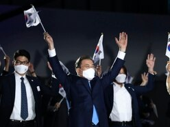 South Korean leader offers olive branch to Japan on liberation day