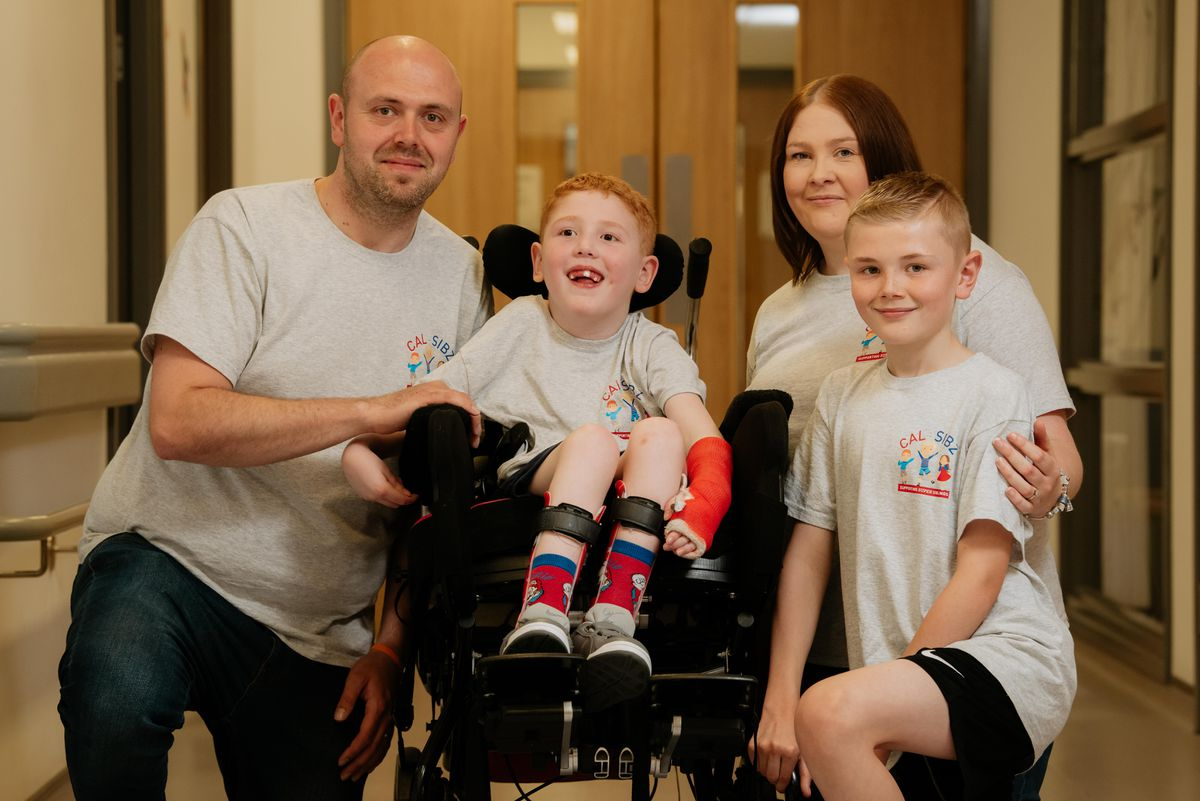 Liam Finazzi, seven, with father Andy, mother Kerry and brother Callum