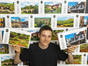 John Hayward with some of the jigsaw puzzles