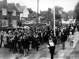 XXXX nostalgia pic. Shrewsbury. Big demonstration by banner-carrying demonstrators in Shrewsbury on October 3, 1973. They are passing the Bricklayers Arms, Shrewsbury. They were protesting before was a hearing into charges against pickets during the building workers' strike, which was a cause celebre court case at Shrewsbury Crown Court. There was a demonstration by around 800 protesters in Shrewsbury that day. Trade unions. Strikers. Strikes. Shrewsbury demonstration. Shrewsbury protest. Demonstrations. Protests. Library code: Shrewsbury nostalgia 2002a. .