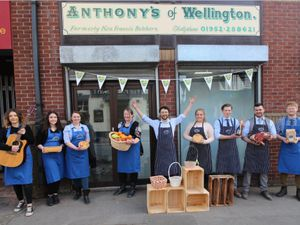 Anthony Nicholls and his team outside his new shop in Wellington