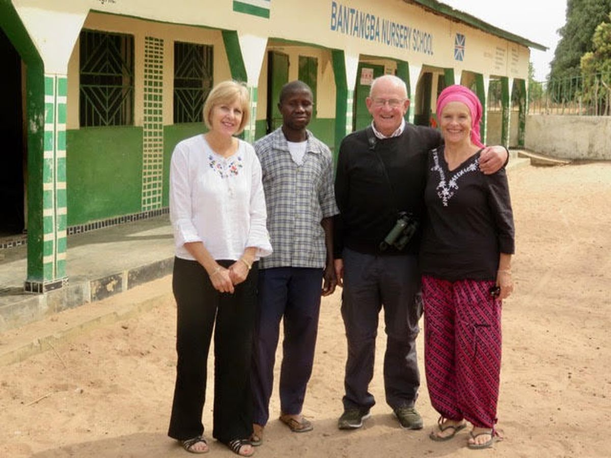 Kate (left) and John Holland with 'Goal for The Gambia' founder, Sandy Sanyang, and the headmaster of Batangba Nursery school at Somita.