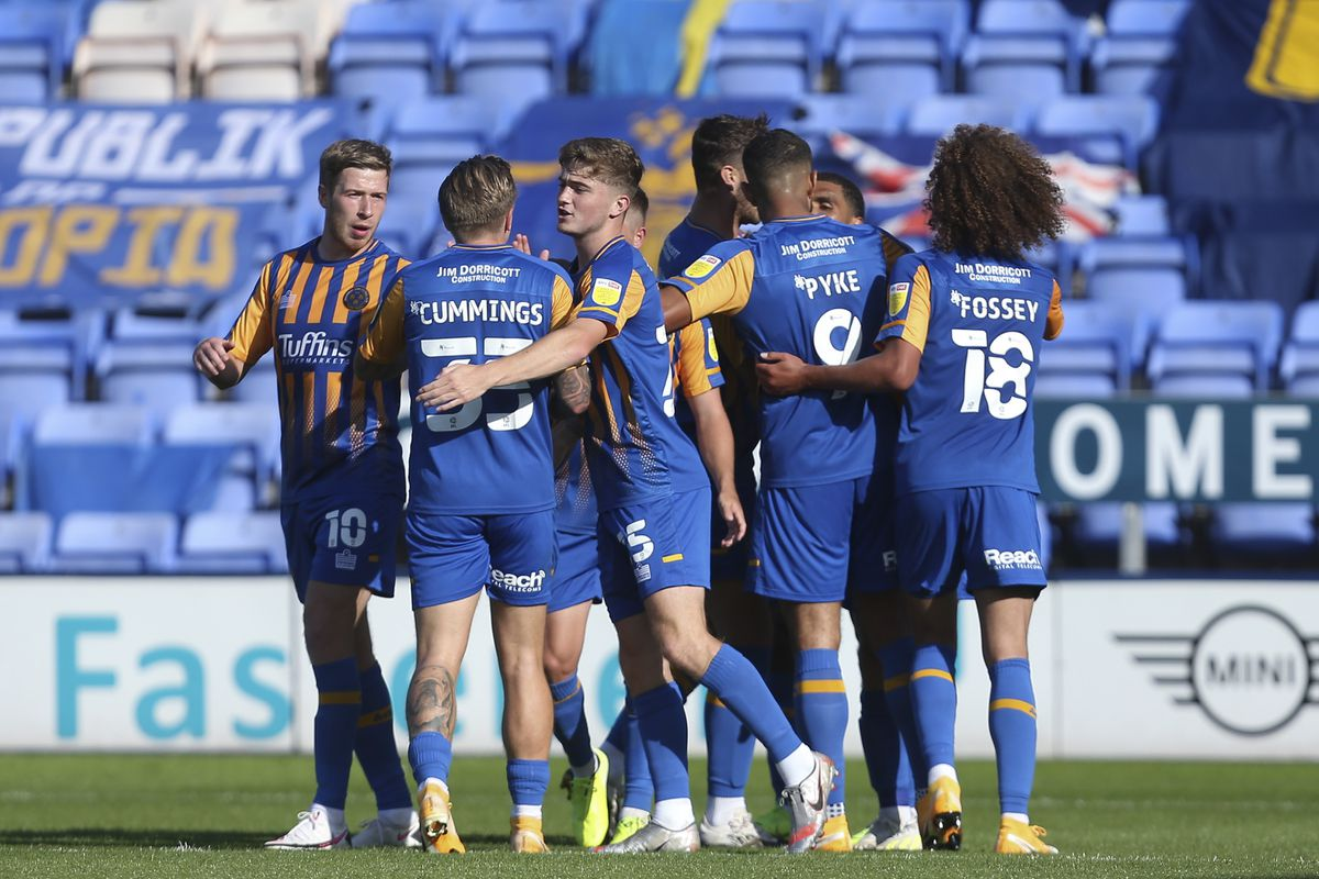 Shaun Whalley of Shrewsbury Town celebrates with his team mates after scoring a goal to make it 1-1. (AMA)
