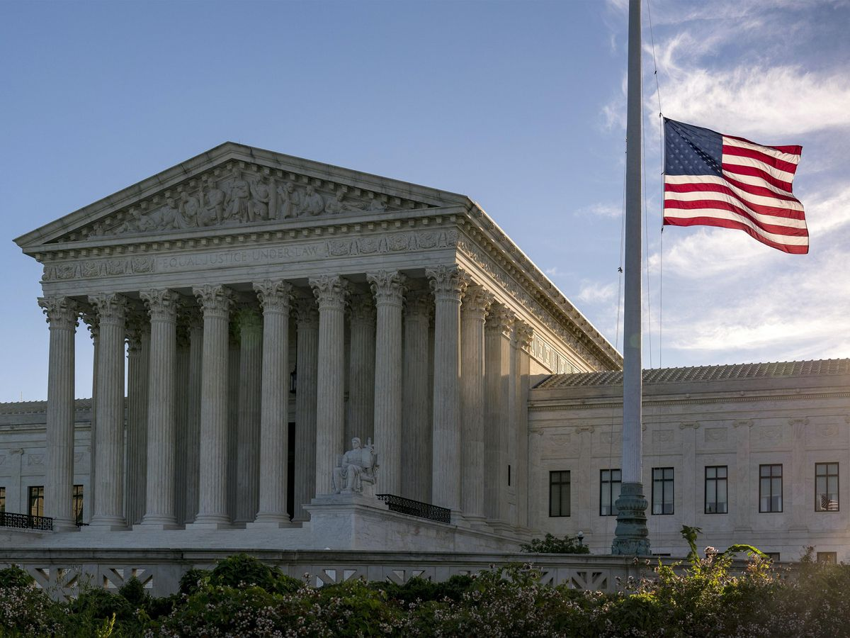 The flag flies at half-mast at the Supreme Court following the death of Justice Ruth Bader Ginsburg (J. Scott Applewhite/AP)