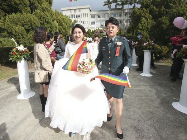 Lesbian couple Chen Ying-hsuan, right, and Li Li-chen attend a military mass weddings ceremony in Taoyuan city, northern Taiwan (Chiang Ying-ying/AP)