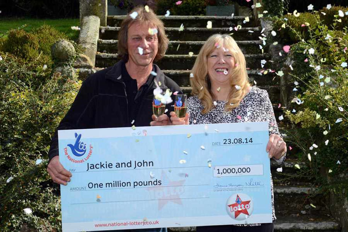 Engaged couple John Potter and Jackie Murphy celebrate their £1 million Lottery scratchcard win