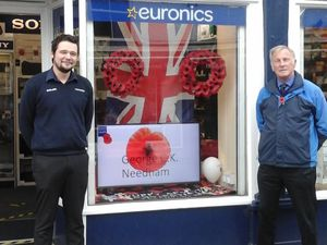Ellesmere Legion branch chairman, Bob McBride, (right), with PeterNicholas, Barlow's assistant store manager who organised the scroll of honour display.
