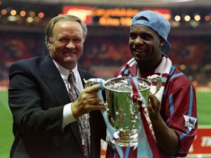 File photo dated 27/03/94 of Aston Villa manager Ron Atkinson holding the Coca-Cola cup with former Aston Villa footballer Dalian Atkinson (right), who died after he was Tasered by police in Telford early on Monday. PRESS ASSOCIATION Photo. Issue date: Monday August 15, 2016. See PA story POLICE Taser. Photo credit should read: Tony Harris/PA Wire.