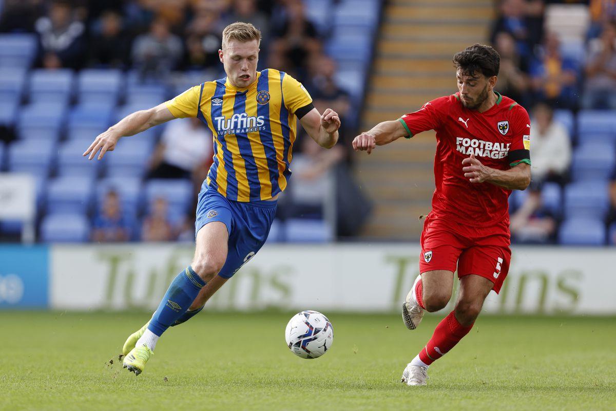 Sam Cosgrove of Shrewsbury Town and Will Nightingale of AFC Wimbledon (AMA)