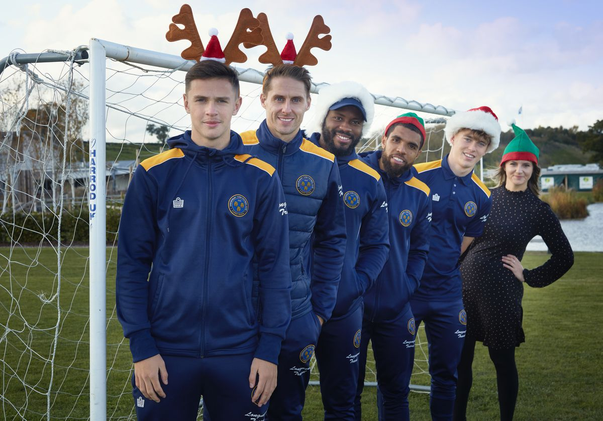 Shrewsbury Town footballers Ryan Barnett, Dave Edwards, Lenell John-Lewis, Scott Golbourne and Luke McCormick with Laura Wilde, Salop Leisure's marketing assistant
