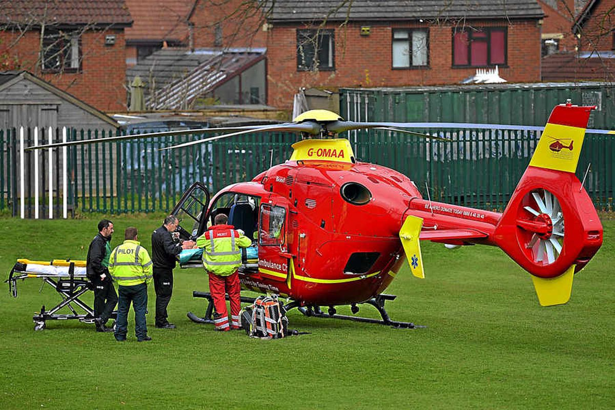 The victim is transferred to the air ambulance