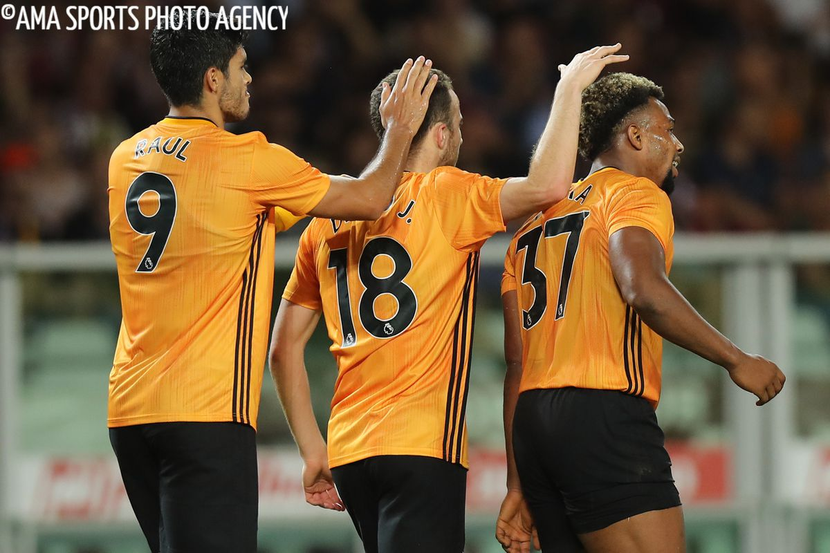 Diogo Jota of Wolverhampton Wanderers celebrates after scoring a goal to make it 0-2 with Raul Jimenez and Adama Traore (AMA)