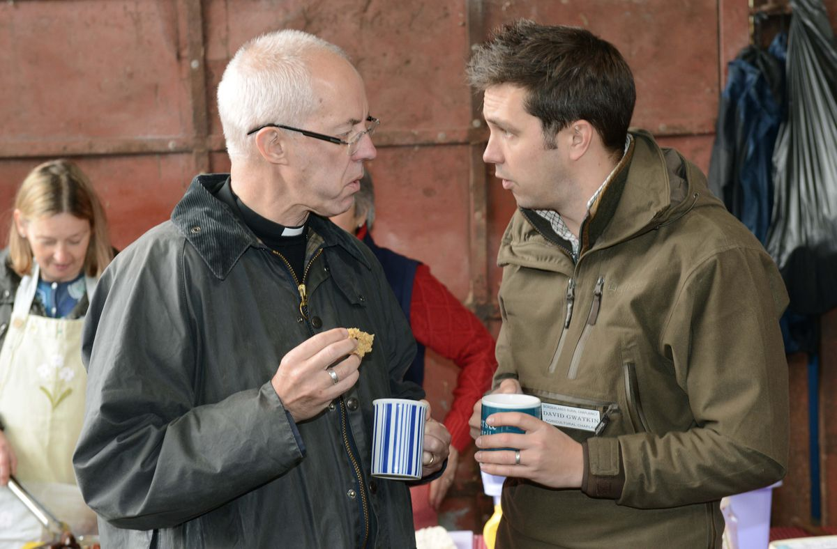 The Archbishop of Canterbury talking to Agricultural Chaplain David Gwatkin at Oakwood Farm in Longville, Much Wenlock