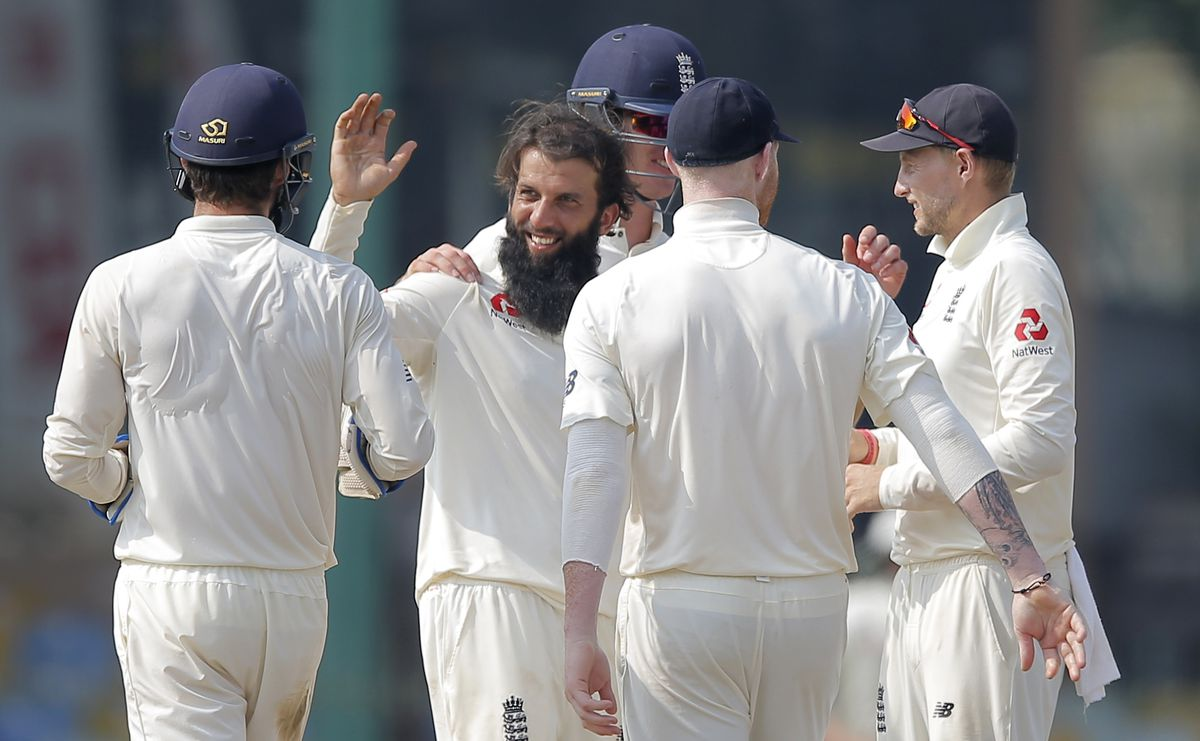 England's Moeen Ali, second left