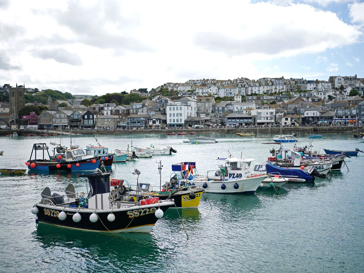 Fishing boats moored in St Ives harbour, in Cornwall
