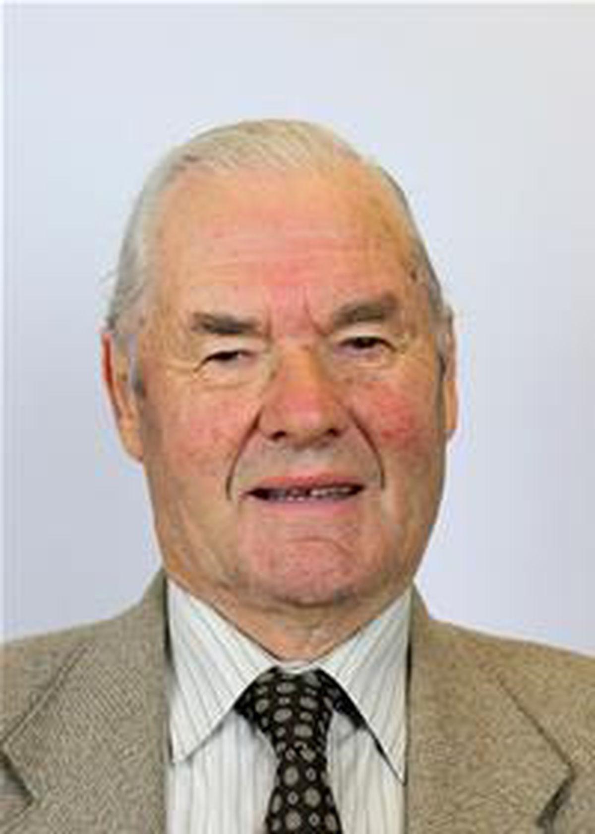 Cllr E.Michael Jones