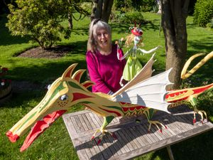 Margaret Lewery with her dragon and a sprite