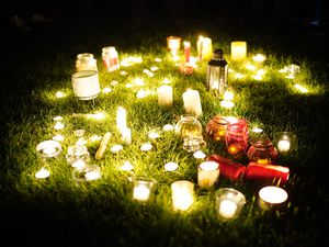 Crowds carrying lanterns and candles gathered in darkness at Belfairs sports ground