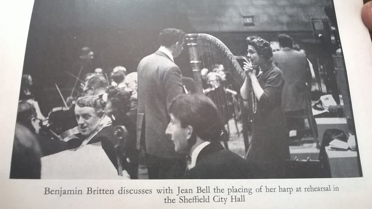 Malcolm Tillis, in the foreground, during his days in the Halle Orchestra, with composer Benjamin Britten talking to harpist Jean Bell