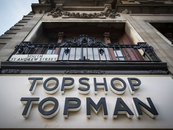 A Topshop/Topman store sign.