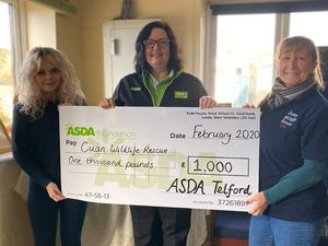 Charlotte Dunne, left, and Fran Hill accept a cheque from Asda