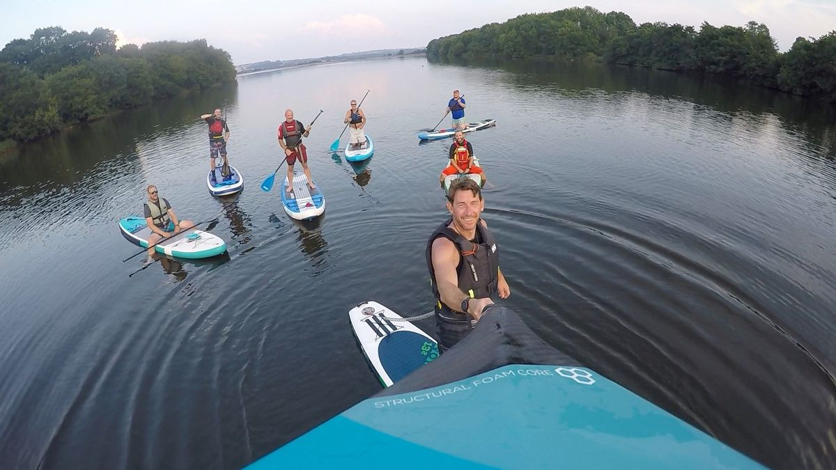 Club member Craig Jackson paddleboarding with friends