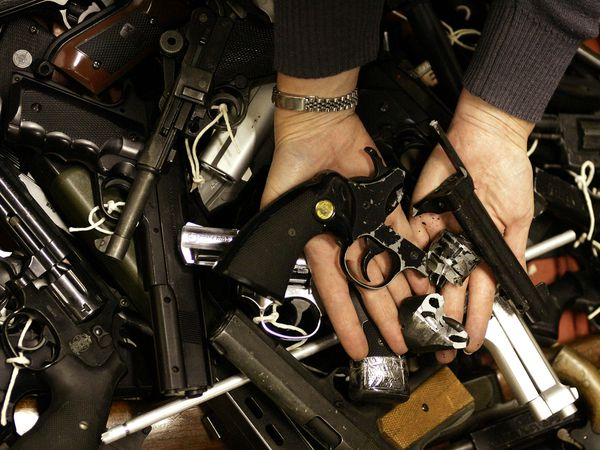A pistol is displayed above a pile of firearms after it was crushed at the start of a two=week gun amnesty in Nottingham in 2004