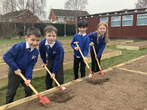 Some of the key worker children have made a head start on getting the school's new allotment ready