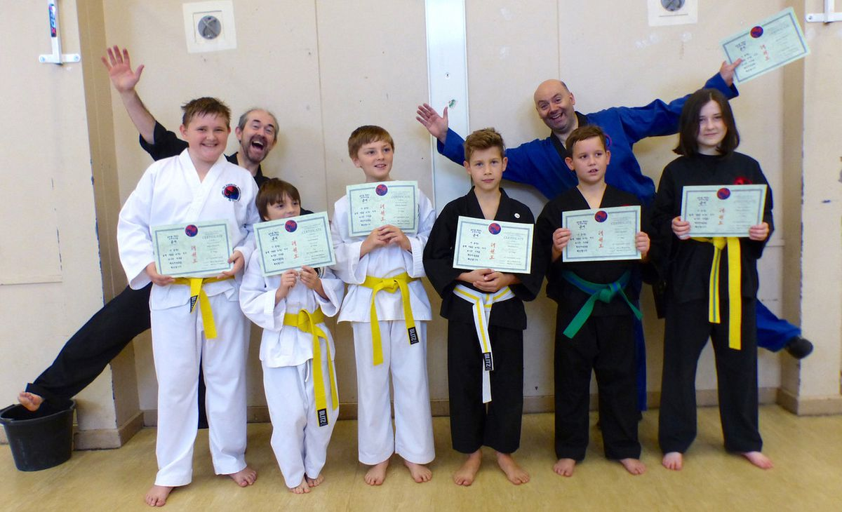 Instructors Declan Kearney and Seamus McGinley with successful juniors at Excalibur Martial Arts