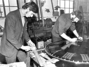 nostalgia pic. Whitchurch. 'Workmen restore face and fingers of a tower clock' was the caption to this picture taken at Whitchurch clock firm Joyce in 1971. This picture was published in the Shropshire Star on Monday, October 25, 1971. The accompanying story began: 'Just over 280 years ago a Shropshire man, George Joyce, set up a business making grandfather clocks. And today the name of Joyce can be found on hundreds of clocks both large and small  - but mostly large - all over the world. The Whitchurch firm of J. B. Joyce and Co. is now in fact part of the John Smith and Sons combine of Derby, but the name Joyce still remains in use and the north Shropshire workshops are still packed with clocks for repair and restoration... Although no actual clocks are now built at Whitchurch, clocks are repaired and restored...' The Whitchurch building was vacated in 2012 when operations were centralised in Derby.This is a print in the Shropshire Star picture archive and has the Shropshire Star copyright stamp. It was taken on October 22, 1971, and the photographer was Brian Bould. The workmen are not named. Clock repairs. Library code: Whitchurch nostalgia 2020..