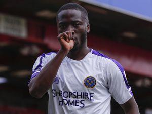 Dan Udoh of Shrewsbury Town celebrates after scoring a goal to make it 2-2.