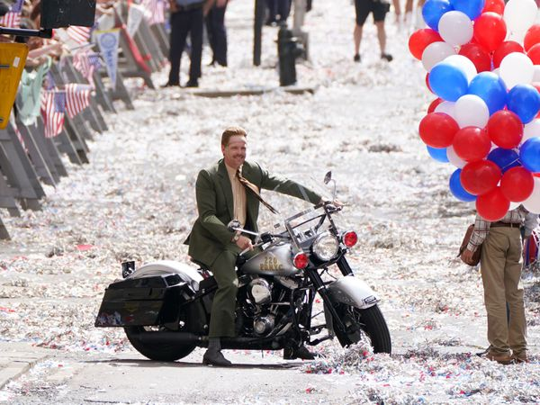A body double for Boyd Holbrook is seen on motorbike during a parade scene on St Vincent Street in Glasgow city centre during filming for what is thought to be the new Indiana Jones 5 movie starring Harrison Ford (Andrew Milligan/PA)