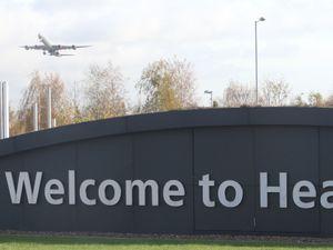 A plane above Heathrow Airport (Steve Parsons/PA)