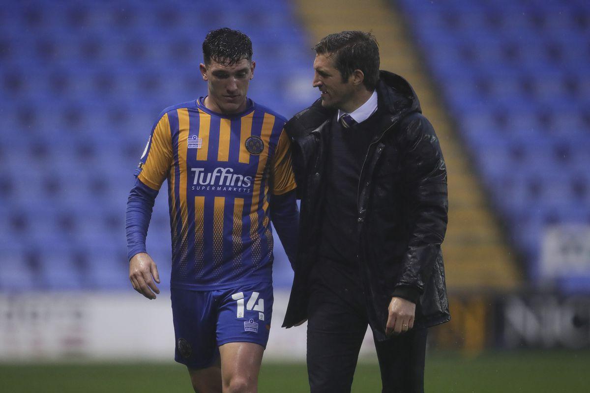 Matthew Millar of Shrewsbury Town and Sam Ricketts the head coach / manager of Shrewsbury Town (AMA)