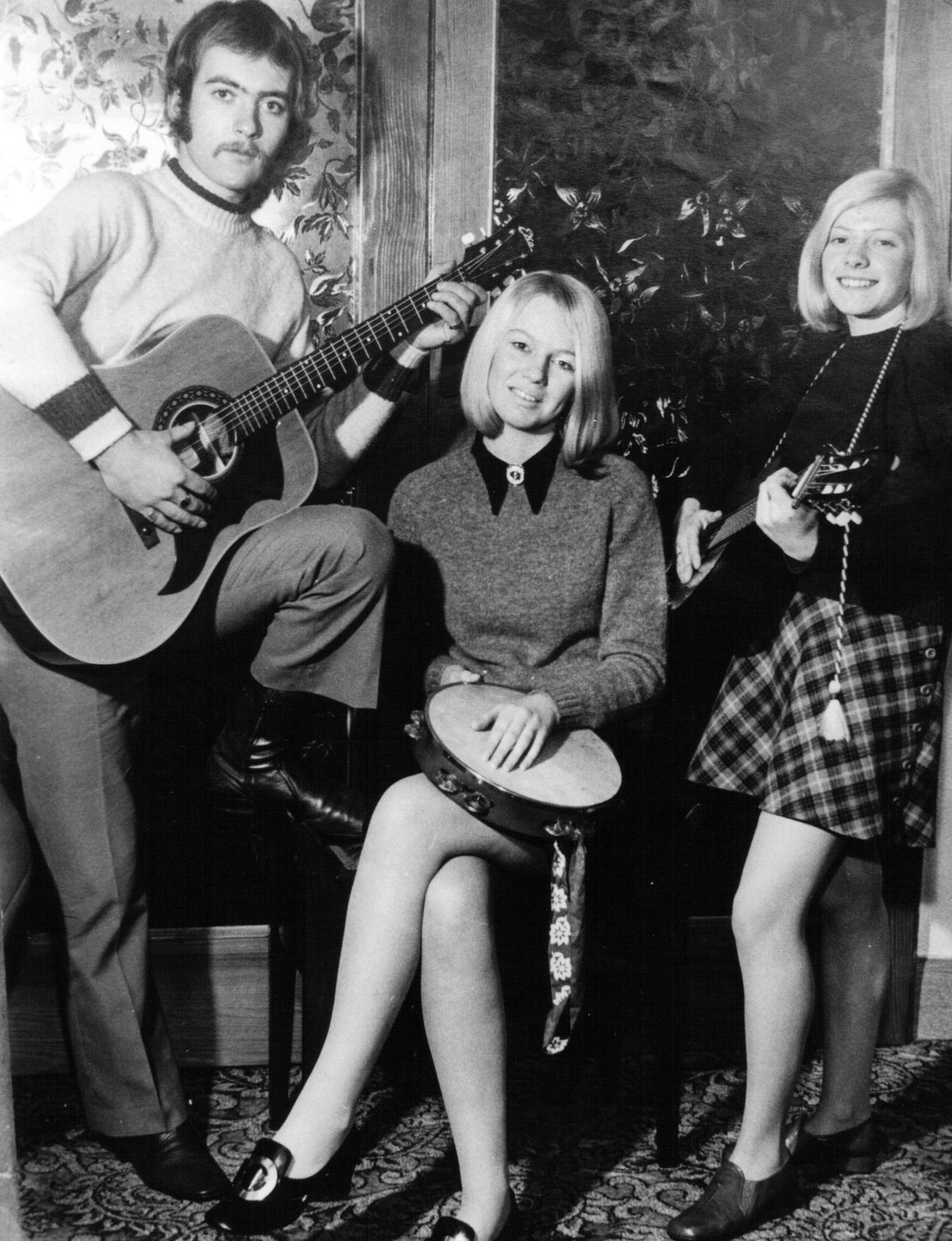 Music was a running thread in his young life – here he is in a folk trio called Pennywood in 1970.