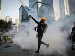 Hong Kong officials decry violence after protesters attack government offices