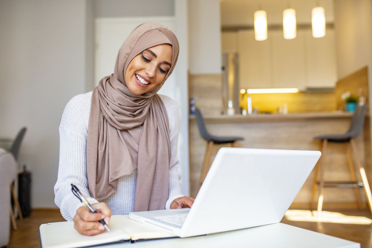 A generic stock photo of a woman working from home.