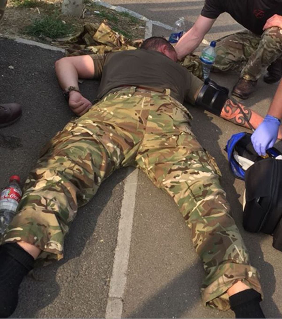 Former soldier David Glanville can be seen on the ground after becoming ill while training