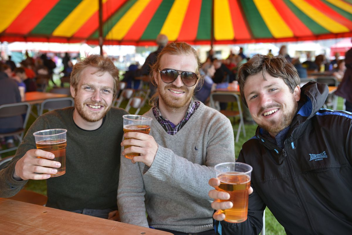 SHREWS WORDS ANDY RICHARDSON. Shrewsbury Folk Festival. Sam Dougherty, left, Ian Swift, centre and Greg Davies, of the Gregory S Davies Band pause for refreshments. PIC BY BOB GREAVES. 23/8/2014