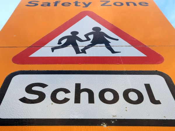 """File photo dated 03/01/21 of a general view of a school safety zone sign. UK retailers are gearing up for a strong back-to-school shopping season in the coming weeks as """"brick and mortar browsing"""" regains momentum, research suggests. Issue date: Sunday August 15, 2021. PA Photo. Retail sales, excluding petrol, are expected to grow by 12% during the August 16 to September 19 back-to-school period, compared with the same period in 2019, before the coronavirus pandemic. See PA story MONEY Parents. Photo credit should read: Mike Egerton/PA Wire."""
