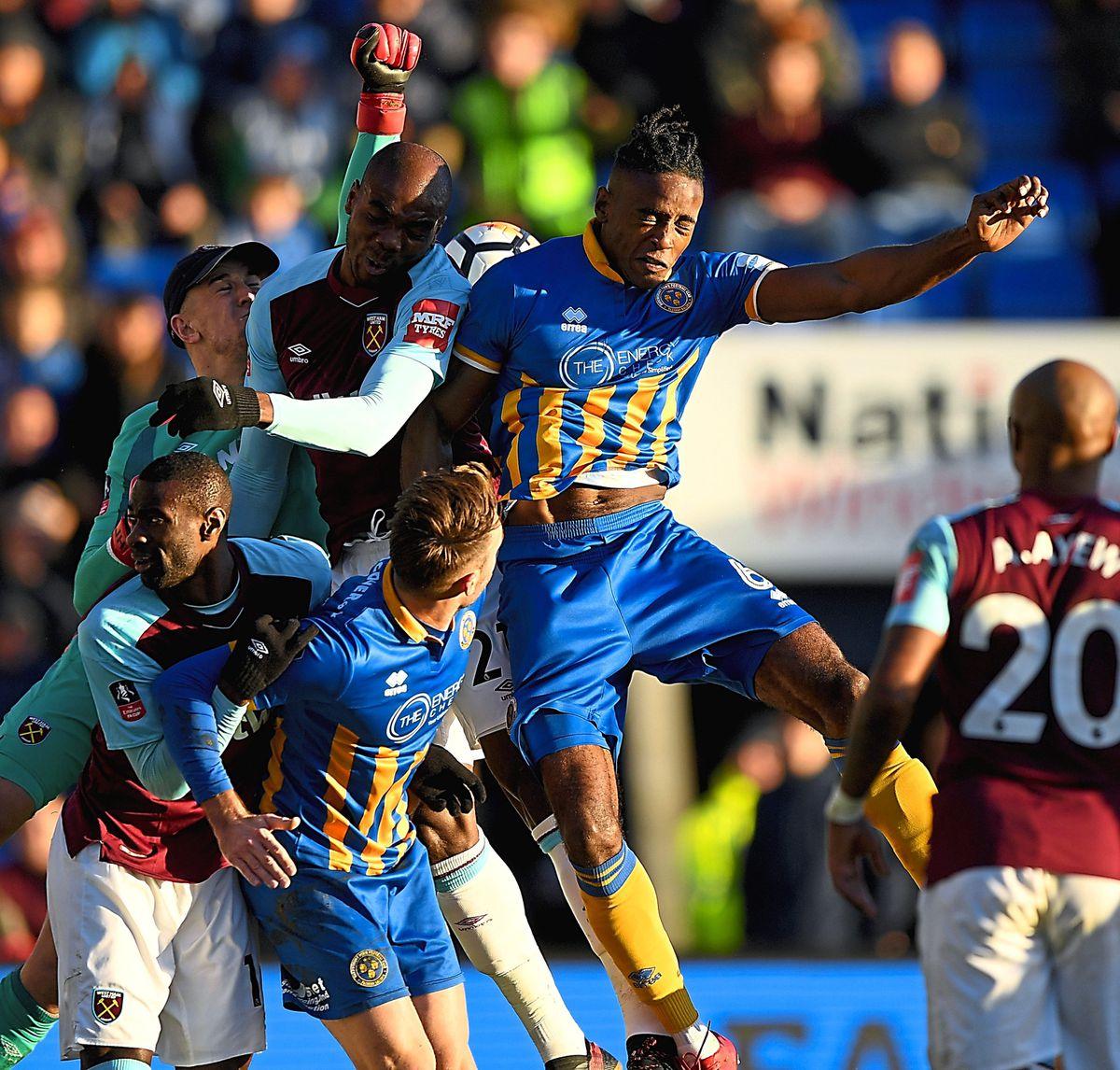 Omar Beckles against West Ham, and Joe Hart, last season (AMA)