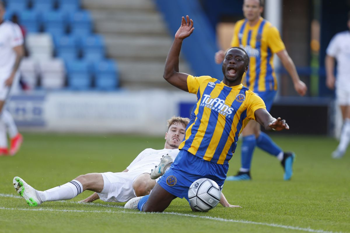 Henry Cowans of AFC Telford United concedes a penalty with this foul on Dan Udoh of Shrewsbury Town. (AMA)