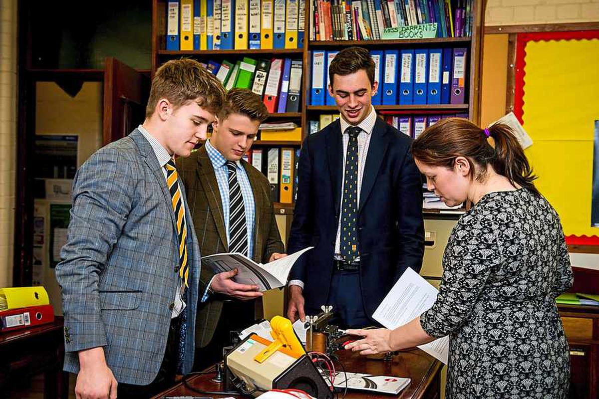 Students at Ellesmere College take time out to check through the school league tables